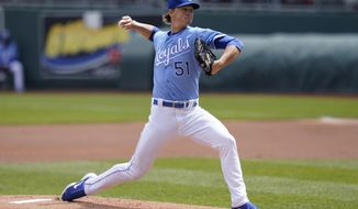 Kansas City Royals starting pitcher Brady Singer delivers to a Toronto Blue Jays batter during the first inning of a baseball game at Kauffman Stadium in Kansas City, Mo., Sunday, April 18, 2021. (AP Photo/Orlin Wagner)