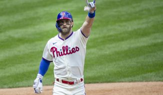 Philadelphia Phillies' Bryce Harper (3) gestures after crossing the plate on a home run during the first inning of a baseball game against the St. Louis Cardinals, Sunday, April 18, 2021, in Philadelphia. (AP Photo/Laurence Kesterson)