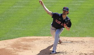 Cleveland Indians' Shane Bieber throws during the first inning of a baseball game against the Cincinnati Reds in Cincinnati, Sunday, April 18, 2021. (AP Photo/Aaron Doster)
