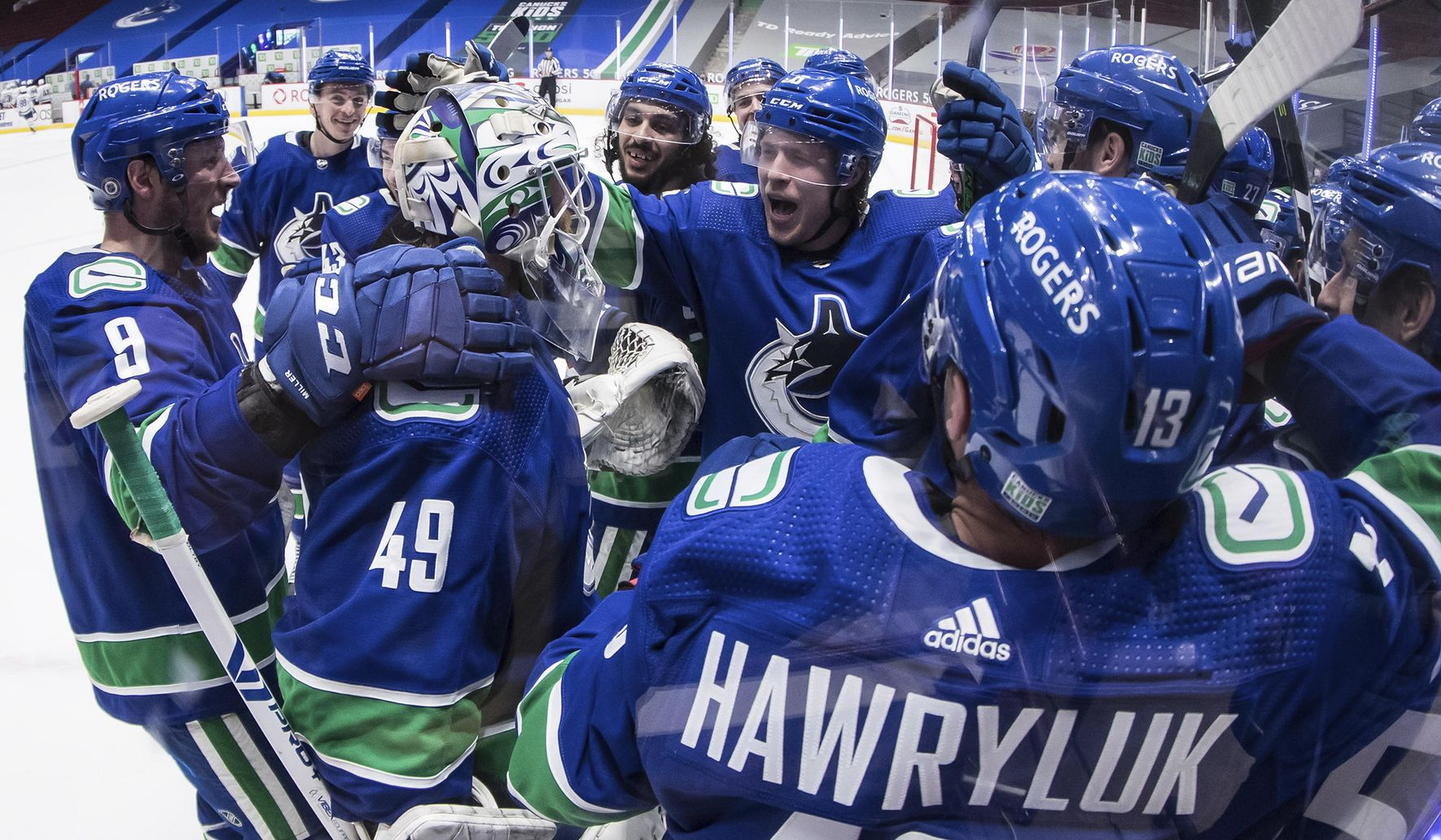 Canucks top Leafs 3-2 in OT in return from COVID layoff