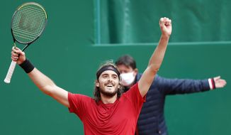 Stefanos Tsitsipas of Greece celebrates after defeating Andrey Rublev of Russia during the Monte Carlo Tennis Masters tournament finals in Monaco, Sunday, April 18, 2021. (AP Photo/Jean-Francois Badias)