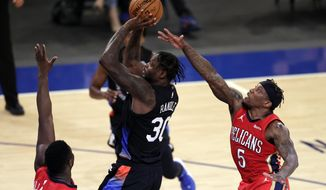 New York Knicks forward Julius Randle (30) shoots in front of New Orleans Pelicans guard Eric Bledsoe (5) during the second half of an NBA basketball game Sunday, April 18, 2021, in New York. (AP Photo/Adam Hunger, Pool)