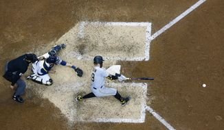 Pittsburgh Pirates' Colin Moran hits an RBI double during the 10th inning of a baseball game against the Milwaukee Brewers Sunday, April 18, 2021, in Milwaukee. (AP Photo/Morry Gash)