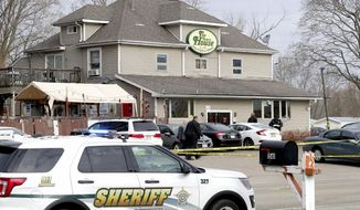 Officials investigate the scene a deadly shooting at Somers House Tavern in Kenosha, Wis., Sunday, April 18, 2021. Several people were killed and two were seriously wounded in a shooting at the busy tavern in southeastern Wisconsin early Sunday, sheriff's officials said. (Mike De Sisti/Milwaukee Journal-Sentinel via AP)