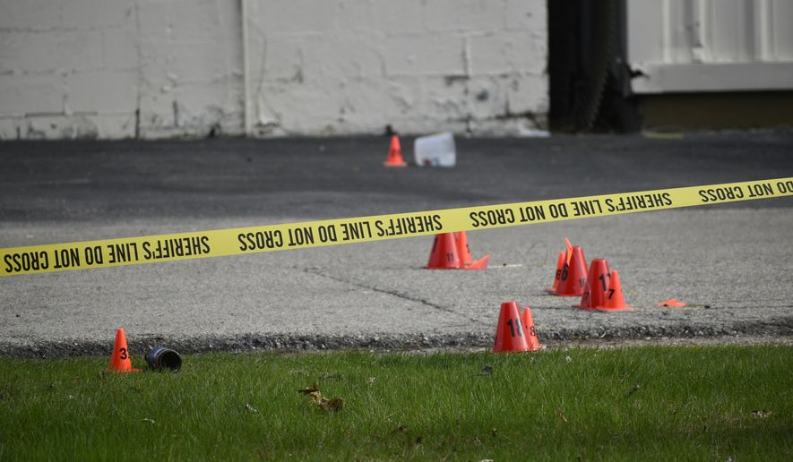Evidence markers and police tape were in abundance outside the Somers House Tavern and down 15th Place, where shots were fired in a fatal shooting Sunday, April 18, 2021, in Kenosha, Wis. Several people were killed and a few were seriously wounded in a shooting at the busy tavern in southeastern Wisconsin early Sunday, sheriff's officials said. (Deneen Smith/The Kenosha News via AP)