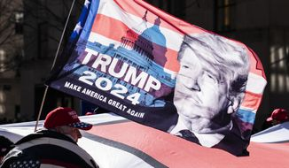 In this March 5, 2021, file photo, protesters supporting former President Donald Trump march down Fifth Avenue on their way toward Times Square in New York. (AP Photo/John Minchillo) ** FILE **