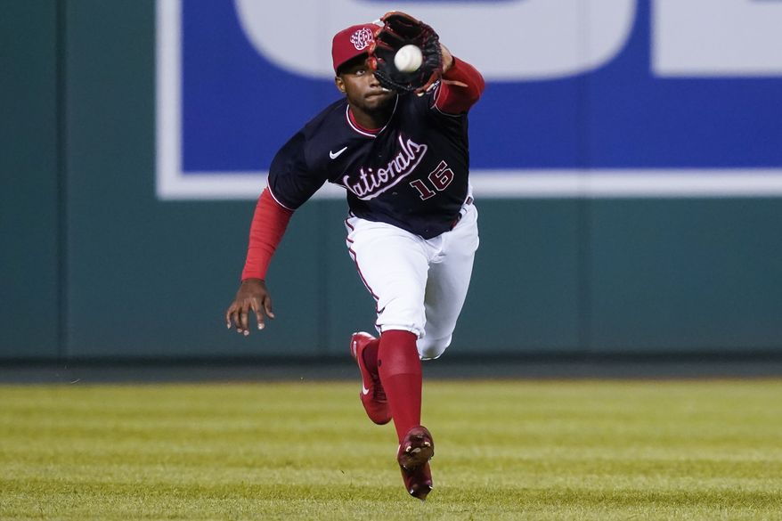 Washington Nationals center fielder Victor Robles catches a fly hit by St Louis Cardinals' Scott Hurst during the ninth inning of a baseball game at Nationals Park, Monday, April 19, 2021, in Washington. (AP Photo/Alex Brandon)