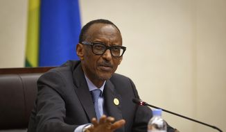 """In this Monday, April 8, 2019, file photo, Rwanda's President Paul Kagame answers questions from the media at a press conference at a convention center in the capital Kigali, Rwanda. A report commissioned by the Rwandan government due to be made public on Monday, April 19, 2021, concludes that the French government bears """"significant"""" responsibility for """"enabling a foreseeable genocide"""" that left more than 800,000 dead in 1994 and that France """"did nothing to stop"""" the massacres. (AP Photo/Ben Curtis, File)"""