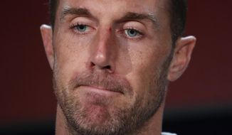 FILE - Washington Redskins quarterback Alex Smith speaks at a news conference after an NFL football game against the Indianapolis Colts in Landover, Md., in this Sunday, Sept. 16, 2018, file photo. Alex Smith is retiring from the NFL after making an improbable comeback from a broken leg. Smith announced his retirement Monday, April 19, 2021, on Instagram, saying he still has plenty of snaps left him just shy of his 37th birthday but is calling it quits to enjoy time with his family. (AP Photo/Alex Brandon, File)
