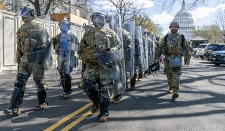 Members of the National Guard leave the Capitol perimeter the they had been guarding, Friday, April 2, 2021, after a car crashed into a barrier on Capitol Hill in Washington. (AP Photo/Jacquelyn Martin)