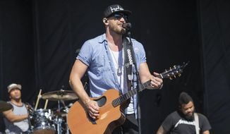 Chase Rice performs with his band at the 4th Annual ACM Party for a Cause Festival at the Las Vegas Festival Grounds in L:as Vegas, in this Sunday, April 3, 2016, file photo. Like many young football players growing up in North Carolina, Chase Rice had his sights set on the NFL. (Photo by Eric Jamison/Invision/AP, File) **FILE**
