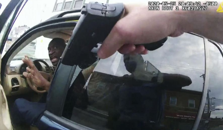 In this image from police body camera video George Floyd responds to police after they approached his car outside Cup Foods in Minneapolis, on May 25, 2020. The image was shown as prosecutor Steve Schleicher gave closing arguments while Hennepin County Judge PeterCahill presided Monday, April 19, 2021, at the Hennepin County Courthouse in Minneapolis, in the trial of former Minneapolis police Officer Derek Chauvin, who is charged in the May 25 death of Floyd. (Court TV via AP, Pool)