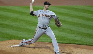San Francisco Giants starting pitcher Kevin Gausman throws during the first inning of a baseball game against the Philadelphia Phillies, Monday, April 19, 2021, in Philadelphia. (AP Photo/Laurence Kesterson)