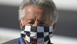 In this Aug. 21, 2020, file photo, Mario Andretti looks on before the final practice session for the Indianapolis 500 auto race at Indianapolis Motor Speedway. Andretti feels the same pain as so many others these days. His wife died two years ago, long before the pandemic. And his beloved nephew lost a brutal battle with colon cancer. But then COVID-19 claimed his twin brother and one of the greatest racers of all time is not immune from the loneliness and depression sweeping the world. (AP Photo/Darron Cummings, File) **FILE**