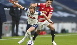 FILE - In this Sunday, April 11, 2021 file photo Tottenham's Harry Kane, left, is challenged by Manchester United's Harry Maguire during the English Premier League soccer match between Tottenham Hotspur and Manchester United at the Tottenham Hotspur Stadium in London. UEFA President Aleksander Ceferin says players at the 12 clubs setting up their own Super League could be banned from this year's European Championship and next year's World Cup. (Clive Rose/Pool via AP)