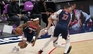 Washington Wizards guard Bradley Beal, left, drives past Oklahoma City Thunder forward Kenrich Williams, center, as Williams is screened by Wizards center Alex Len in the second half of an NBA basketball game, Monday, April 19, 2021, in Washington. (AP Photo/Patrick Semansky)