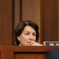 Sens. Mike Lee and Amy Klobuchar wrote to Apple CEO Tim Cook to urge him to attend the antitrust hearing this week. (Associated Press photographs)