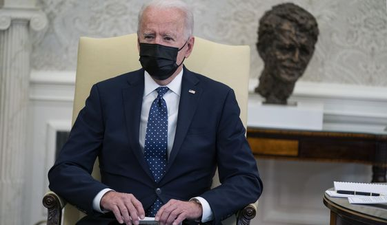 President Joe Biden speaks during a meeting with members of the Congressional Hispanic Caucus, in the Oval Office of the White House, Tuesday, April 20, 2021, in Washington. (AP Photo/Evan Vucci)