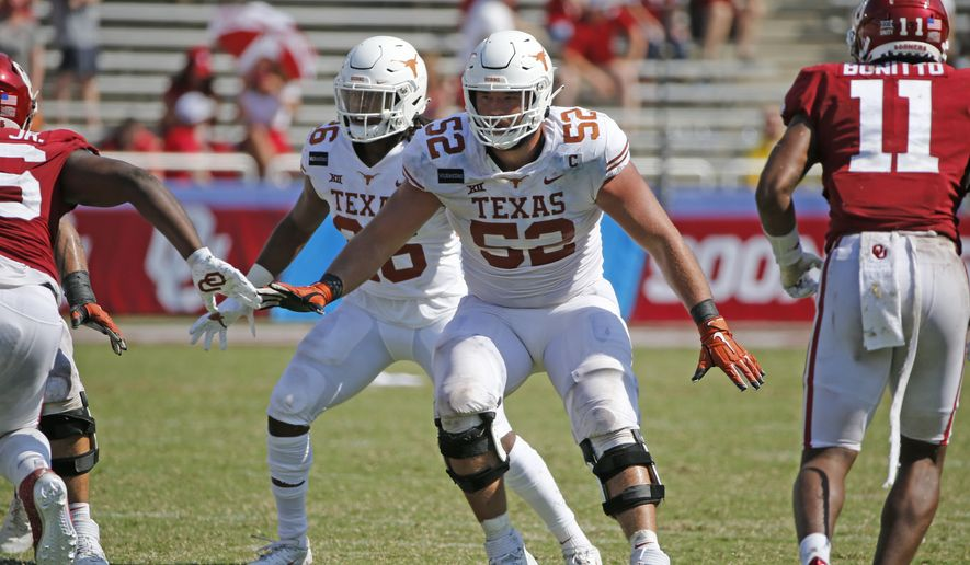 Texas offensive lineman Samuel Cosmi (52) prepares to block against Oklahoma during the second half of an NCAA college football game in Dallas, Texas, in this Saturday, Oct. 10, 2020, file photo. The Kansas City Chiefs already have spent the offseason rebuilding an offensive line ravaged by injuries and then dominated by Tampa Bay in the Super Bowl. But there is still work to be done, and the next opportunity to provide some help up front for quarterback Patrick Mahomes is the NFL draft. (AP Photo/Michael Ainsworth, File) **FILE**