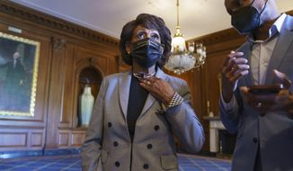 Rep. Maxine Waters, D-Calif., listens to an aide as she joins members of the Congressional Black Caucus to await the verdict in the murder trial of former Minneapolis police Officer Derek Chauvin in the death of George Floyd, on Capitol Hill in Washington, Tuesday, April 20, 2021. (AP Photo/J. Scott Applewhite)