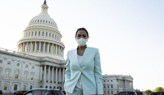 Rep. Alexandria Ocasio-Cortez D-NY, pauses for a photo on her way to an interview on Capitol Hill in Washington, Tuesday, April 20, 2021, after the jury returned guilty verdicts on all three charges in the murder trial of former Minneapolis police Officer Derek Chauvin in the death of George Floyd. (AP Photo/Jose Luis Magana)