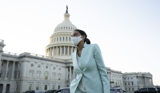 Rep. Alexandria Ocasio-Cortez D-NY, walks to an interview on Capitol Hill in Washington, Tuesday, April 20, 2021, after the jury returned guilty verdicts on all three charges in the murder trial of former Minneapolis police Officer Derek Chauvin in the death of George Floyd. (AP Photo/Jose Luis Magana)