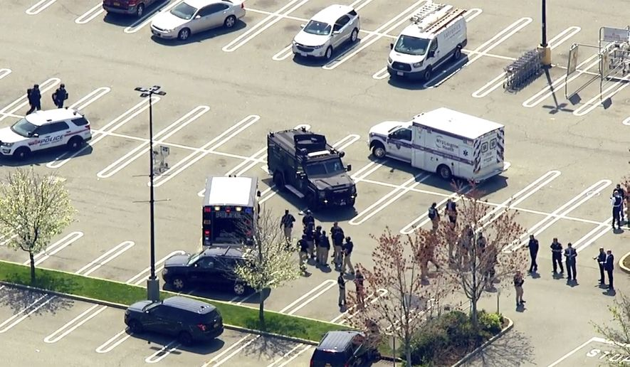 This aerial photo provided by WABC shows police responding to the scene of a shooting at a Stop & Shop supermarket in West Hempstead, N.Y., on Tuesday, April 20, 2021.   Nassau County Executive Laura Curran said in a tweet Tuesday there had been shooting at the Long Island supermarket and that the suspect has not been apprehended. (WABC via AP)