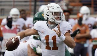 In this Oct. 24, 2020, file photo, Texas' Sam Ehlinger looks to pass against Baylor during the first half of an NCAA college football game in Austin, Texas. Who would make a college football Super League? Think big-brand schools with large fanbases and a history of success ... such as Texas. (AP Photo/Chuck Burton, File) **FILE**