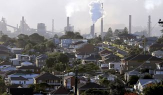 FILE - In this July 2, 2014, file photo, gasses billow from chimneys at a steel factory in Port Kembla, south of Sydney. Australia's Prime Minister Scott Morrison on Wednesday, April 21, 2021, proposed spending an additional 539 million Australian dollars ($417 million) on hydrogen and carbon sequestration projects in an announcement that bolsters his government's green credentials ahead of a climate summit to be hosted by U.S. President Joe Biden. (AP Photo/Rob Griffith, File)