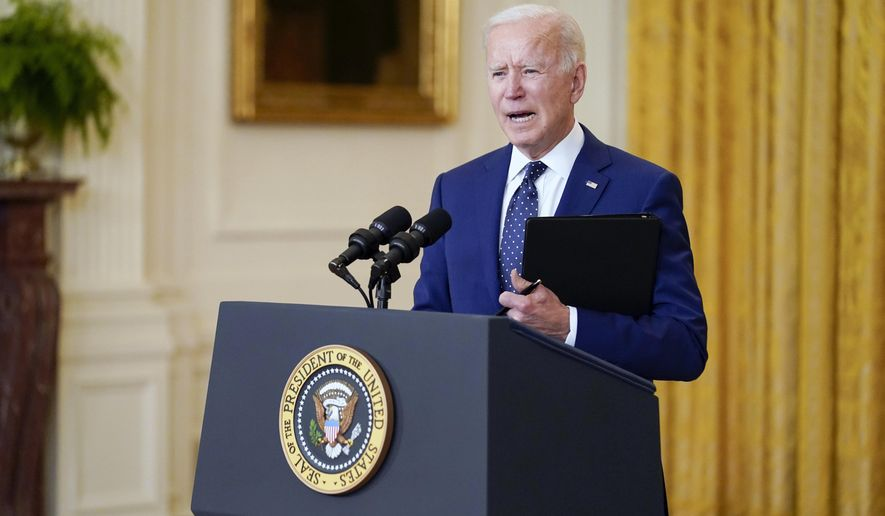 In this April 15, 2021, photo, President Joe Biden speaks about Russia in the East Room of the White House in Washington. Biden is being forced to go virtual for many of his leader-to-leader talks during the pandemic and the resulting Zoom meetings just aren't a natural fit for the back-slapping politician. Biden's big climate summit this week with dozens of world leaders is a moment for him to play cheerleader in the fight against global warming.  (AP Photo/Andrew Harnik)