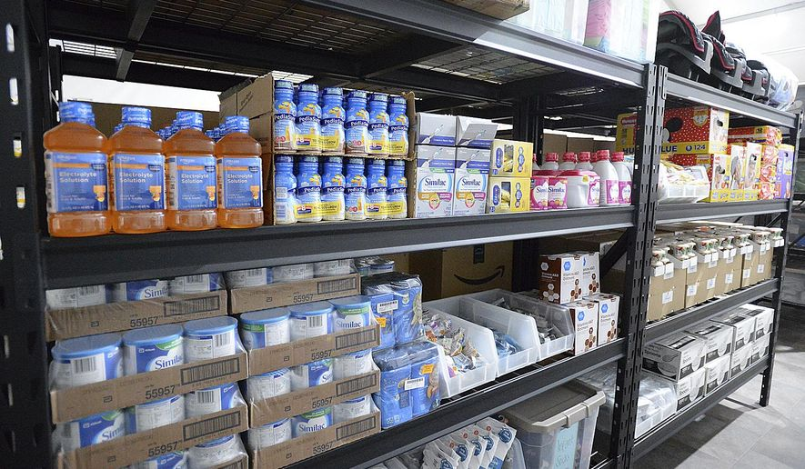 Shelves inside a storage room are stocked with items for infants during an open house at the U.S. Border Patrol Yuma Sector processing facility Tuesday, April 20, 20201, in Yuma, Ariz. (Randy Hoeft/The Yuma Sun via AP)