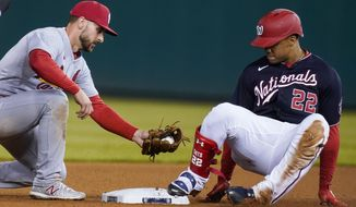Washington Nationals' Juan Soto (22) is safe a second base with double ahead of the tag by St Louis Cardinals shortstop Paul DeJong (11) during the seventh inning of a baseball game at Nationals Park, Monday, April 19, 2021, in Washington. (AP Photo/Alex Brandon)