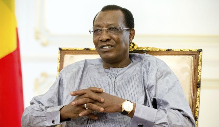 In this Wednesday, April 20, 2016 file photo, Chadian President Idriss Deby Itno meets with U.S. Ambassador to the United Nations Samantha Power at the presidential palace in N'Djamena, Chad, Wednesday, April 20, 2016. Chadian President Idriss Deby Itno, who ruled the central African nation for more than three decades, was killed on the battlefield Tuesday, April 20, 2021, in a fight against rebels, the country's top military commander announced on national television and radio. (AP Photo/Andrew Harnik, File)