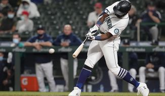 Seattle Mariners' Taylor Trammell hits an RBI-double to score Luis Torrens during the fourth inning of a baseball game against the Los Angeles Dodgers, Monday, April 19, 2021, in Seattle. (AP Photo/Ted S. Warren)