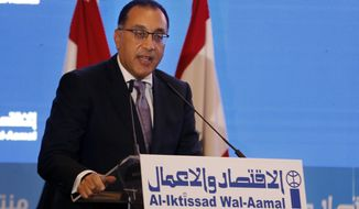 FILE - In this May 2, 2019 file photo, Egyptian Prime Minister Mustafa Madbouly, speaks during the opening session of the Arab Economic Forum in Beirut, Lebanon. Madbouly arrived  Tuesday, April 20, 2021, in Tripoli along with 11 members of his Cabinet and businessmen to discuss ties and trade with the country's newly-appointed government. (AP Photo/Bilal Hussein, File)