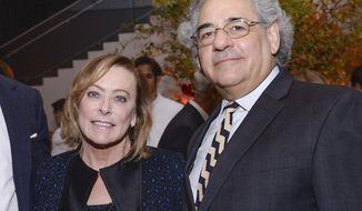 """FILE -  Fox Searchlight co-presidents Nancy Utley, left, and Steve Gilula attend the after-party for """"He Named Me Malala"""" in New York on Sept. 24, 2015. Utley and Steve Gilula who in their two decades at Searchlight Pictures oversaw the releases of major hits including """"Juno,"""" """"Slumdog Millionaire,"""" """"Little Miss Sunshine"""" and """"The Grand Budapest Hotel"""" are retiring. (Photo by Evan Agostini/Invision/AP, File)"""