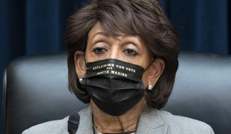 House Financial Services Committee Chairwoman Maxine Waters, D-Calif., presides over a markup of pending bills, on Capitol Hill in Washington, Tuesday, April 20, 2021. (AP Photo/J. Scott Applewhite) **FILE**