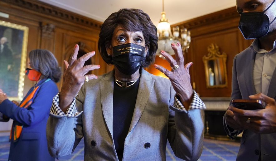 Rep. Maxine Waters, D-Calif., talks on Capitol Hill in Washington on Tuesday, April 20, 2021, as she waits for the verdict to be read in the murder trial of former Minneapolis police Officer Derek Chauvin in the death of George Floyd. (AP Photo/J. Scott Applewhite)