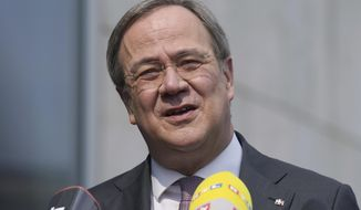 Armin Laschet, chairman of the German Christian Democratic party (CDU), addresses the media during a statement in front of the party's headquarters in Berlin, Germany, Monday, April 19, 2021. (AP Photo/Michael Sohn)