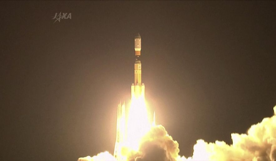 FILE - In this Aug. 4, 2013, file photo taken from video, Japan's  Japan Aerospace Exploration Agency, JAXA, H-2B rocket lifts off from a launch pad at the Tanegashima Space Center in Tanegashima, southern Japan. The Japanese government said Tuesday that Tokyo police are investigating cyberattacks on about 200 companies and research organizations in Japan, including one on the country's JAXA space agency by a hacking group linked to the Chinese military.(AP Photo/JAXA via AP video,File)