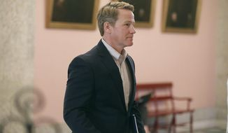 Ohio Lt. Gov. Jon Husted walks out of a news conference on Monday, March 23 2020 at the Ohio Statehouse in Columbus, Ohio. Ohio's lieutenant governor promised a group of Asian American neighbors during a weekend meeting that he would use his public platform to speak out against unwarranted violence facing their community, but he failed to apologize for the divisive tweet that prompted their concern. (Doral Chenoweth/The Columbus Dispatch via AP)