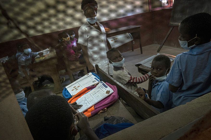 Displaced children attend a class in one of the educational centers set up by a local NGO in Pemba, Mozambique, after they fled attacks in Palma in Northern Mozambique, Monday April 19, 2021. The damage caused by Mozambique's extremist rebels in their deadly assault on the northeastern town of Palma continues to be assessed. More than three weeks after the rebels launched a three-pronged attack, which lasted at least five days, Mozambican police and relief agencies are working to help the thousands uprooted by the violence and restore the town to daily life.(AP Photo)