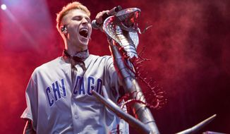 FILE - Machine Gun Kelly performs at Wrigley Field in Chicago, in this Saturday, Sept. 8, 2018, file photo. Grammy Award nominated rock & soul duo Black Pumas and Cleveland's own Machine Gun Kelly will perform at next week's NFL draft.The league announced its musical acts for the second and third days of the draft, which is back on the road after being all virtual last year due to the COVID-19 pandemic.(Ashlee Rezin/Chicago Sun-Times via AP, File)