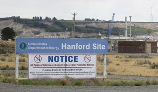 FILE - In this July 9, 2014 file photo, a sign informs visitors of prohibited items on the Hanford Site near Richland, Wash. The U.S. Department of Energy has confirmed that two underground structures at the decommissioned Hanford nuclear reservation in Washington state have been stabilized after they were deemed at risk of collapsing and spreading radioactive contamination into the air. (AP Photo/Ted S. Warren, File)