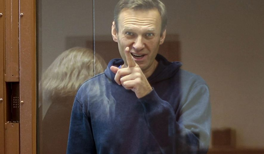 In this Feb. 16, 2021, file photo taken from footage provided by the Babuskinsky District Court, Russian opposition leader Alexei Navalny gestures during a court hearing in Moscow, Russia. Several doctors were prevented Tuesday, April 20, from seeing Navalny in a prison hospital after his three-week hunger strike, and prosecutors also detailed a sweeping, new case against his organization. (Babuskinsky District Court Press Service via AP, File)
