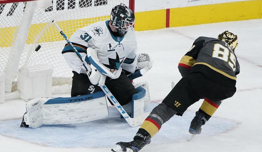 Vegas Golden Knights right wing Alex Tuch (89) scores on San Jose Sharks goaltender Martin Jones (31) during a shootout in an NHL hockey game Monday, April 19, 2021, in Las Vegas. (AP Photo/John Locher)