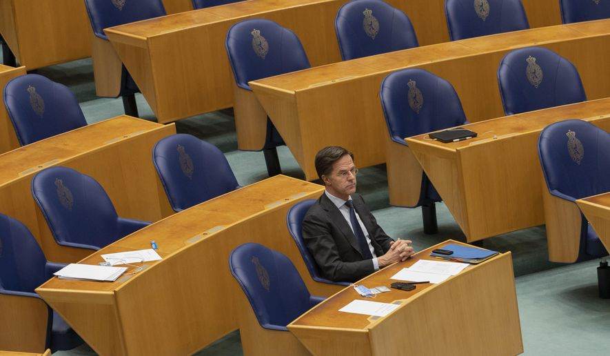FILE - In this file photo dated  Thursday, April 1, 2021, Dutch caretaker Prime Minister Mark Rutte listens to a debate in parliament in The Hague, Netherlands. Rutte announced a significant easing in his country's months-long coronavirus lockdown Tuesday April 20, 2021, calling it a delicate balancing act as infections remain stubbornly high, and as lockdown fatigue grows.(AP Photo/Peter Dejong)