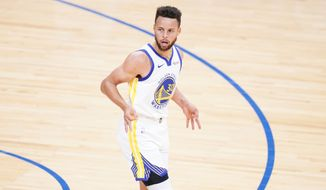 Golden State Warriors' Stephen Curry reacts after making a three-pointer during the first half of an NBA basketball game against the Philadelphia 76ers, Monday, April 19, 2021, in Philadelphia. (AP Photo/Matt Slocum)