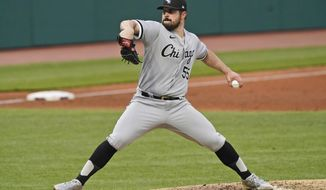 Chicago White Sox starting pitcher Carlos Rodon delivers in the third inning in a baseball game against the Cleveland Indians, Tuesday, April 20, 2021, in Cleveland. (AP Photo/Tony Dejak)