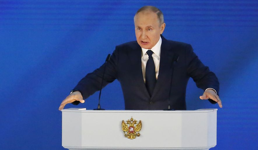 Russian President Vladimir Putin gives his annual state of the nation address in Manezh, Moscow, Russia, Wednesday, April 21, 2021. (AP Photo/Alexander Zemlianichenko) ** FILE **